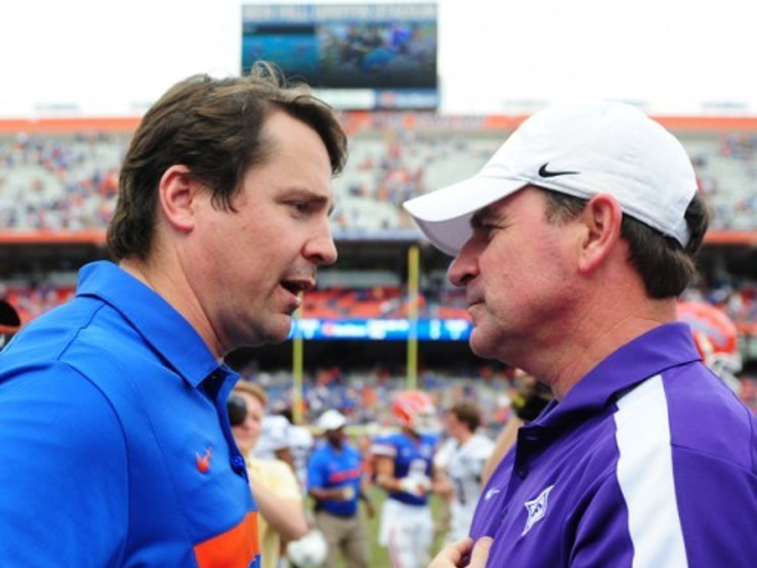 Florida coach Will Muschamp (left) said Furman coach Bruce Fowler (right) deserved credit for confusing the Gators' defense in Saturday's 54-32 win.