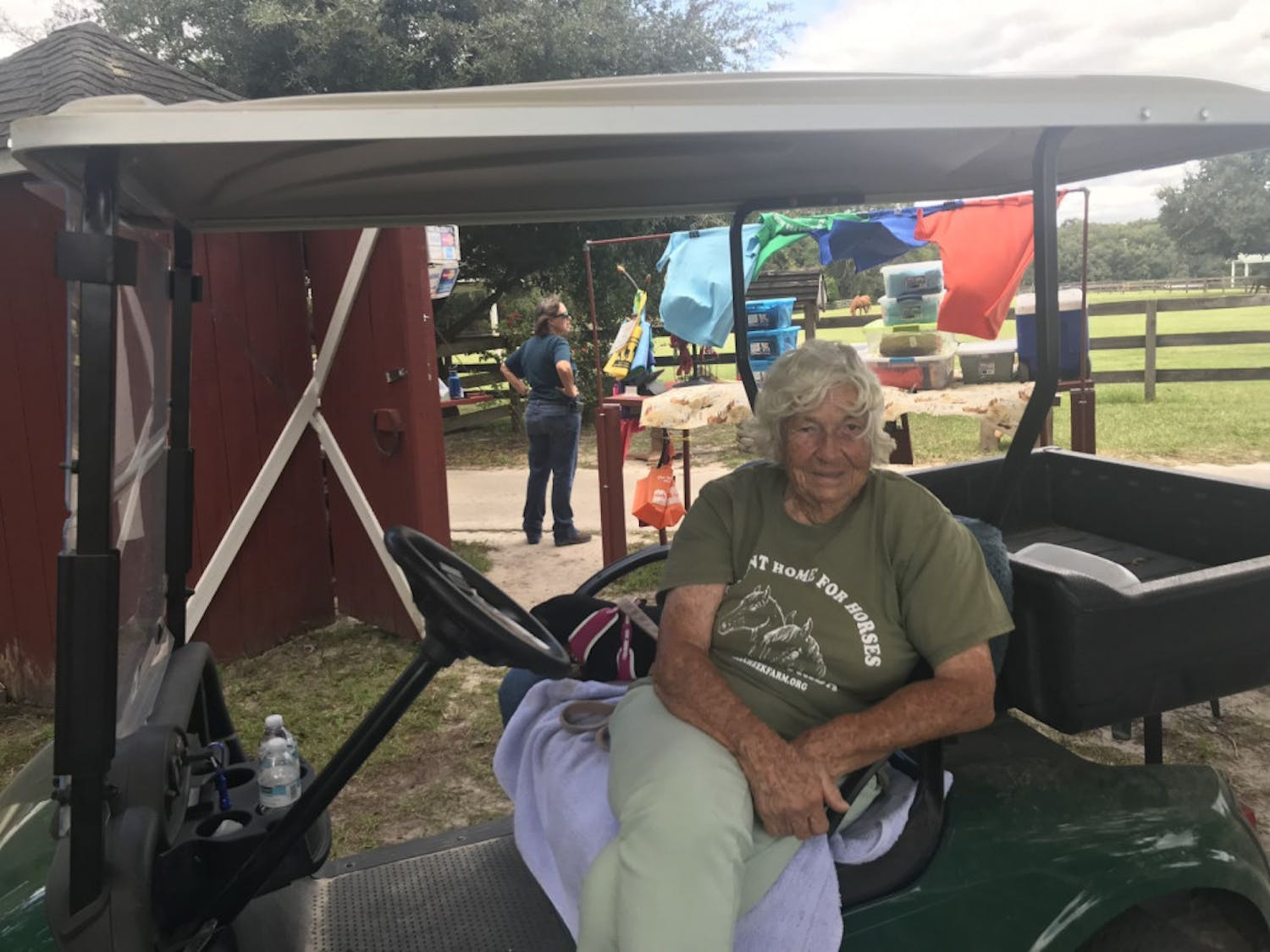 Mary Gregory, co-founder of the Retirement Home for Horses Inc., gets around the 335 acre property on a golf cart with her companion, Minnie, a rescue dachshund, by her side.