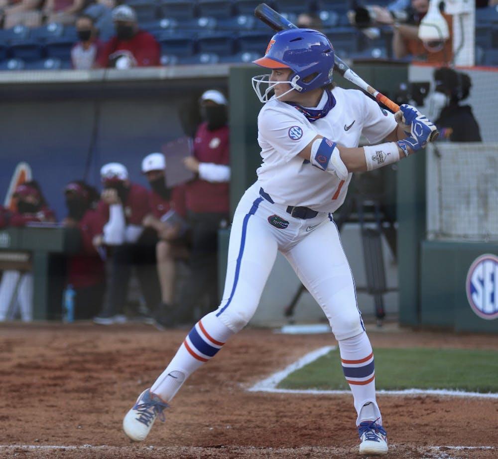 <p>Infielder Hannah Adams prepares her swing March 3 against Florida State. Adams extended her career-long hitting streak to 11 games Saturday. </p>