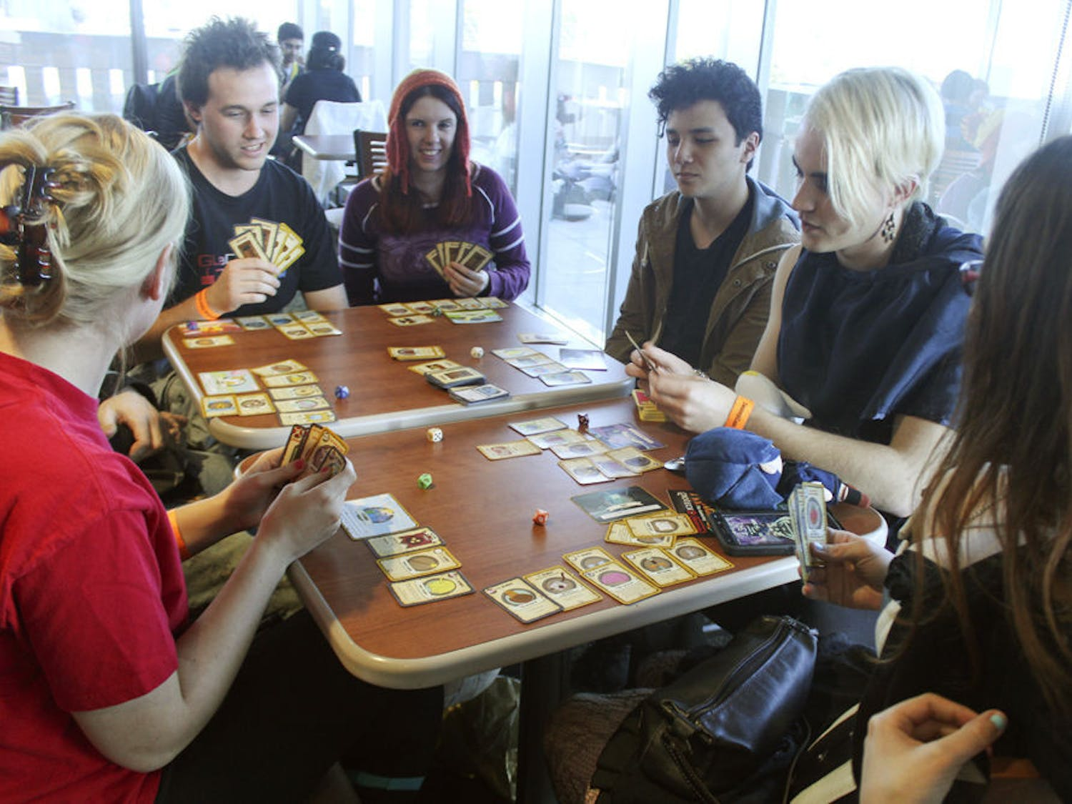 SwampCon visitors participate in a Munchkin, a card game, tournament Saturday during SwampCon at the Arrendondo Cafe in the Reitz Union.