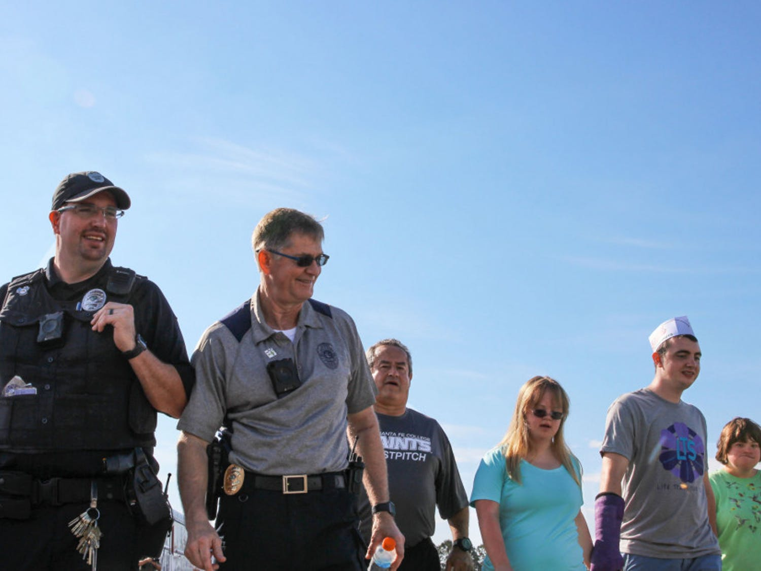 """Santa Fe Police Chief Ed Book participates in the Fourth Annual """"Run With The Cops"""" walk at the Santa Fe track. He is joined by fellow officers, Gainesville locals, students, organizations,and many more."""