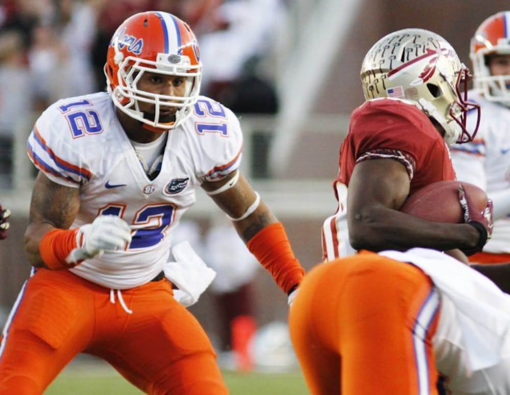 <p>Linebacker Antonio Morrison attempts a tackle during Florida's 37-26 win against Florida State on Saturday at Doak Campbell Stadium.&nbsp;</p>