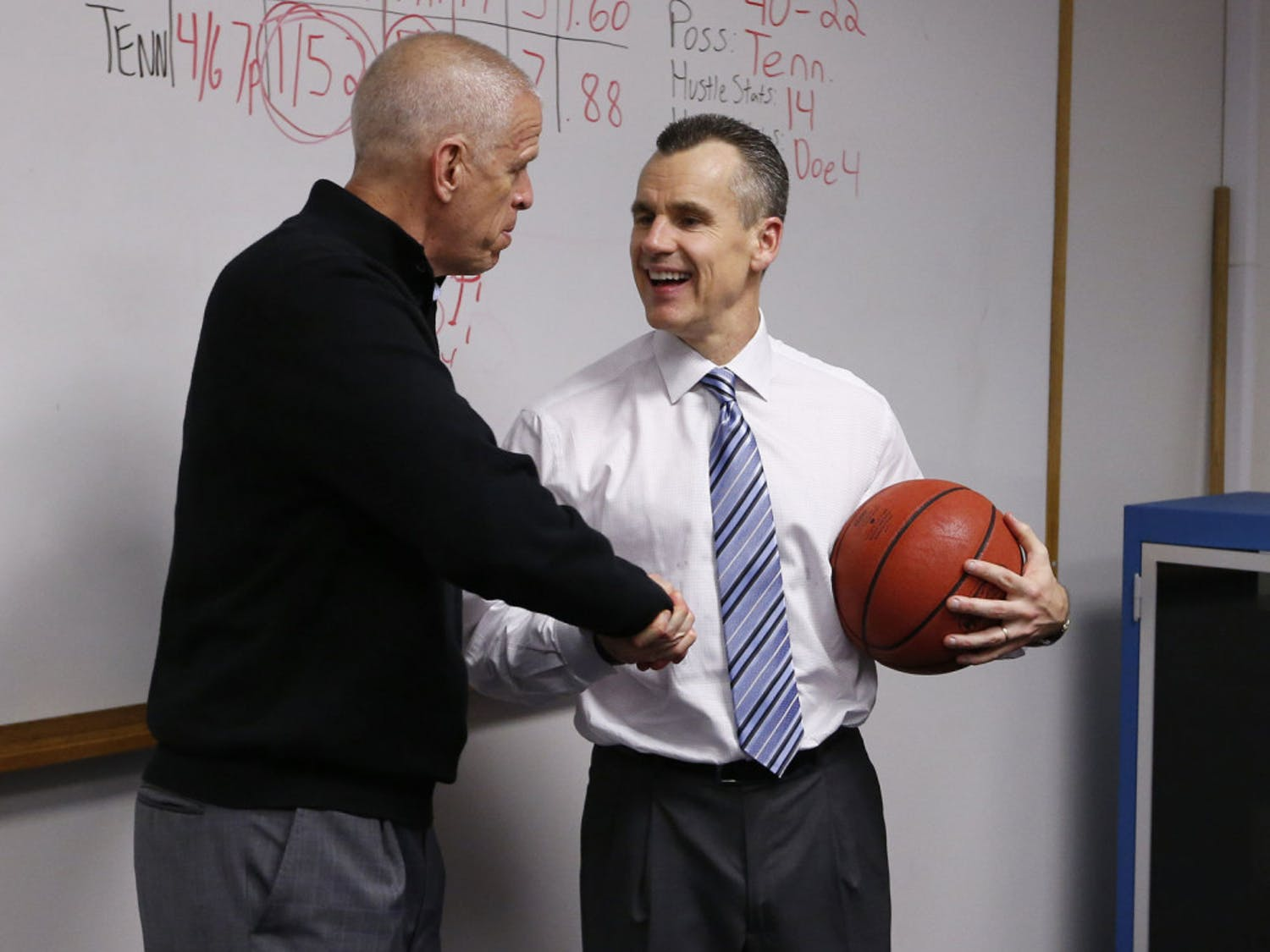 Jeremy Foley shakes hands with Billy Donovan during the Gators' game against the Tennessee Volunteers on Saturday, February 28, 2015, at the Stephen C. O'Connell Center in Gainesville, FL / UAA Communications photo by Tim Casey