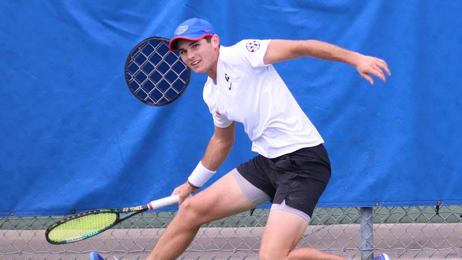 Gators men's tennis will head westward to continue a three-game win streak. Photo from UF-Auburn match Feb. 21.