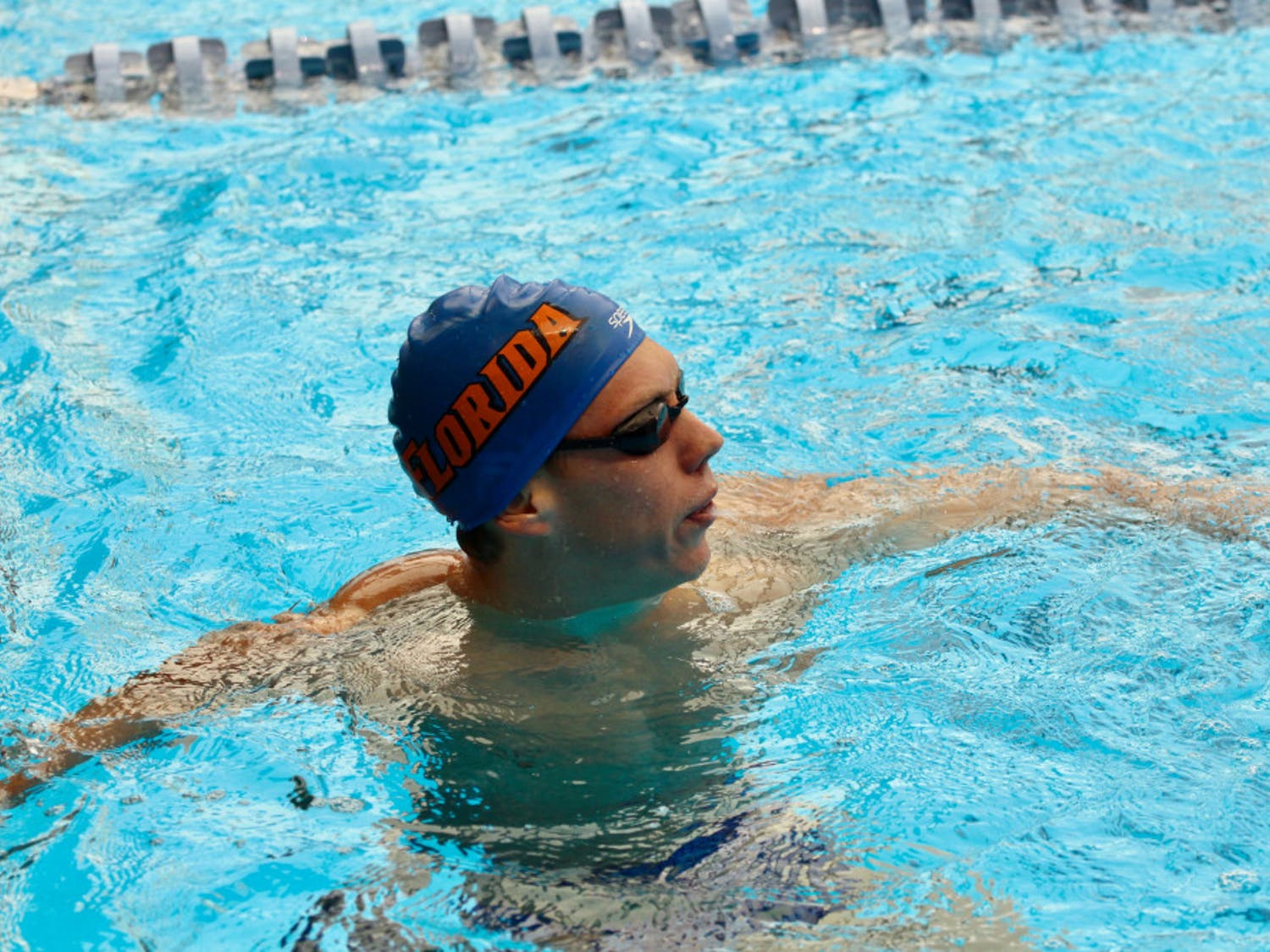 UF swimmer Jan Switkowski won three individual competitions to help the Gators men's swimming and diving team beat Georgia on Friday for the first time since 2013.