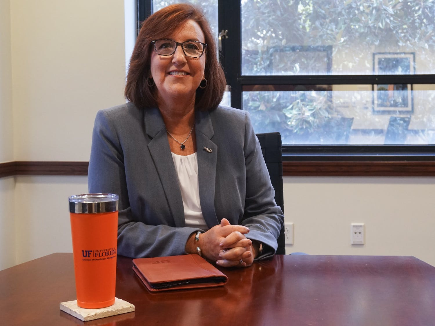 Mary Parker, the University of Florida's new vice president for enrollment management and associate provost, poses for a portrait in her Criser Hall office on Thursday, Aug. 4, 2021.