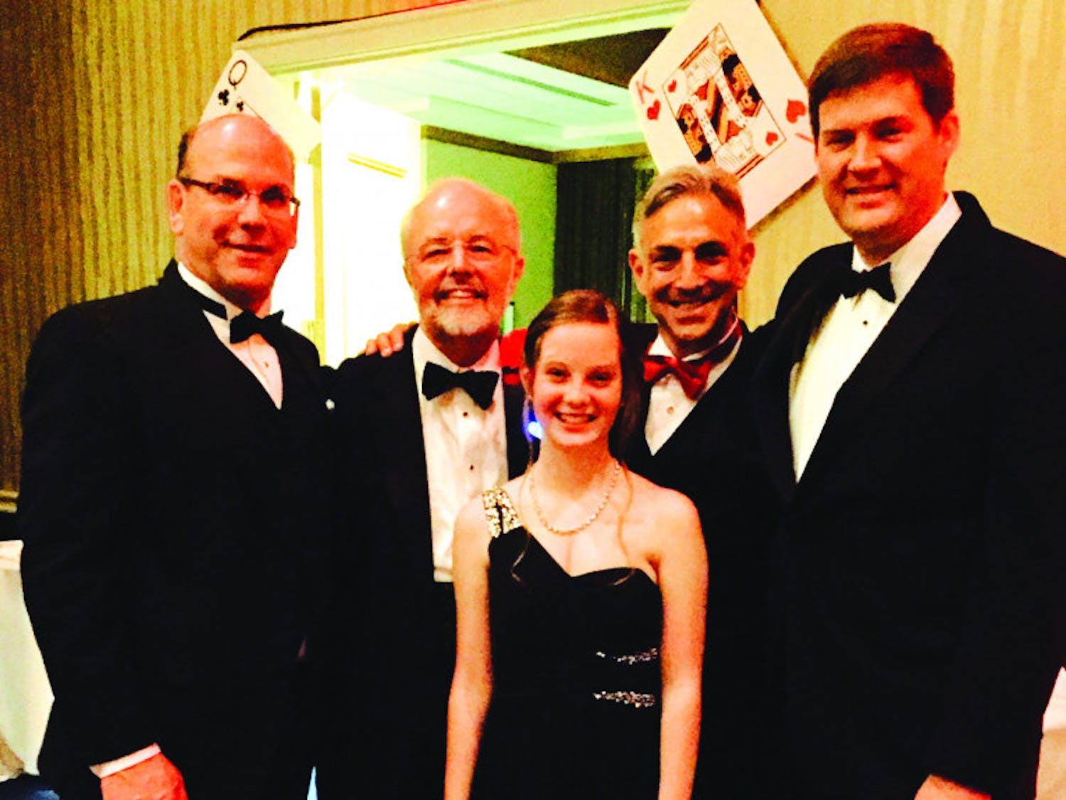 Dr. Biagio Pietra, Dr. Jay Fricker, Dr. Mark Bleiweis and Dr. James Fudge pose with Cristina Cinca, who received a heart transplant from UF Health Shands Hospital in September 2014, at the American Heart Association Heart Ball on Feb. 14, 2016. Bleiweis performed Cinca's surgery, and Fricker was her cardiologist.