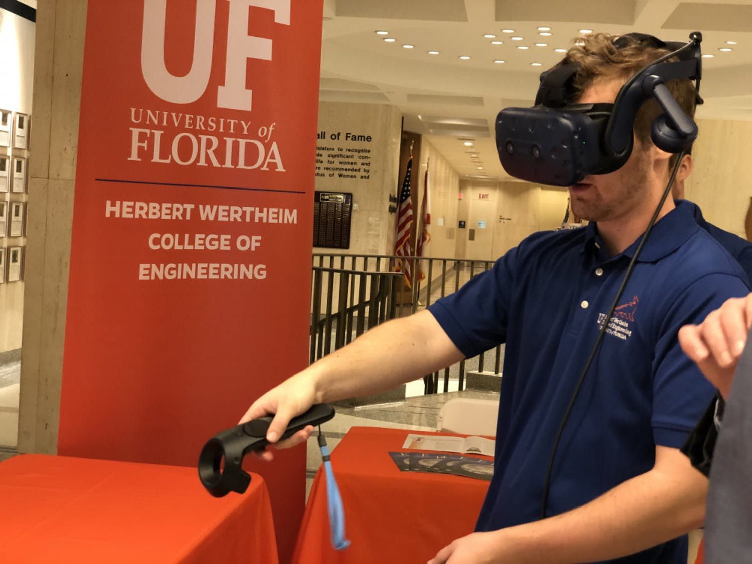 Adam Lizek, a 20-year-old UF computer science junior, uses virtual reality as part of the College of Engineering's Gator Day display. The college is researching virtual reality applications in education to create smart classrooms, Lizek said.