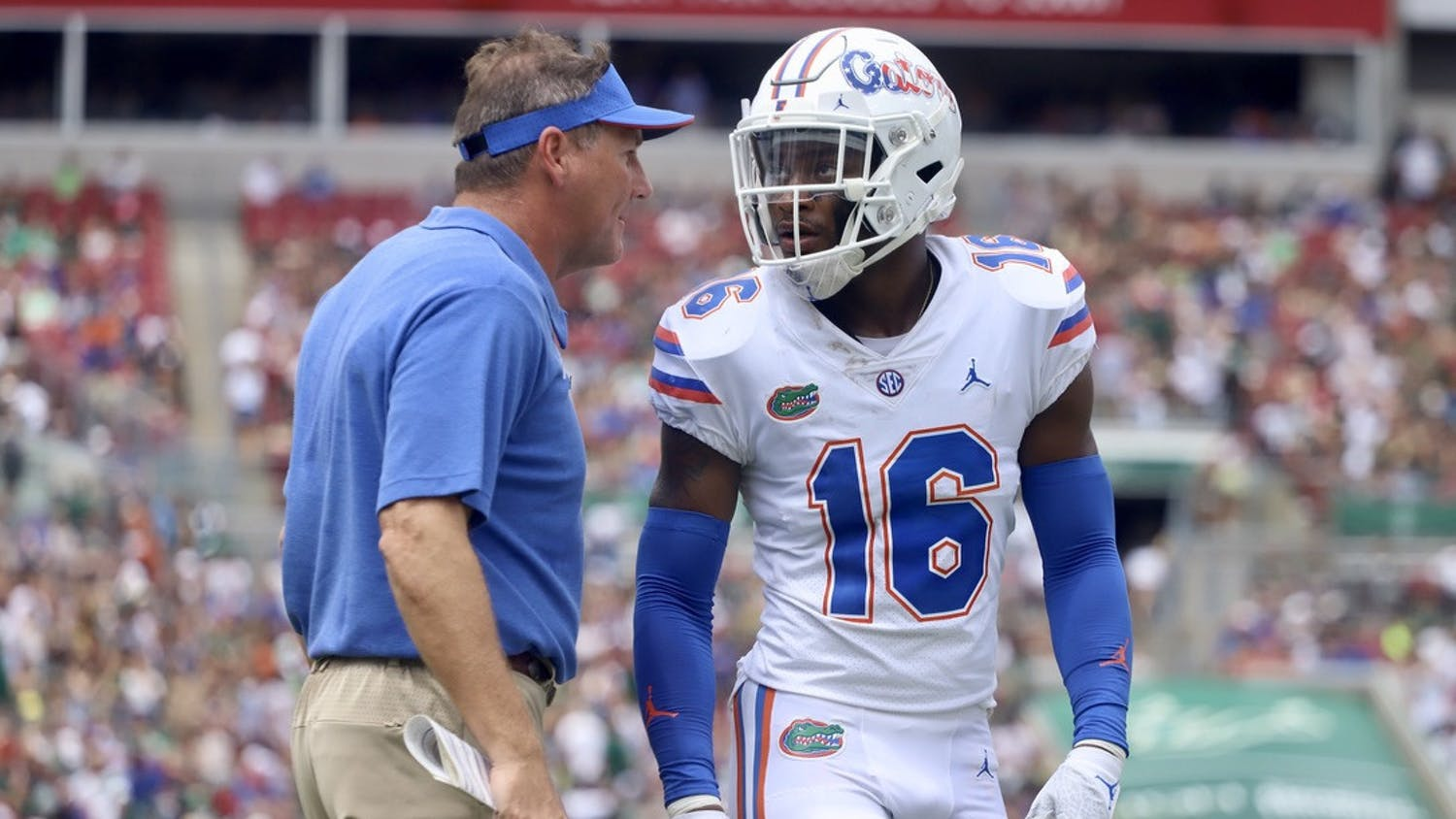 Florida's Tre'Vez Johnson and head coach Dan Mullen talk during their game against South Florida on Sept. 11.