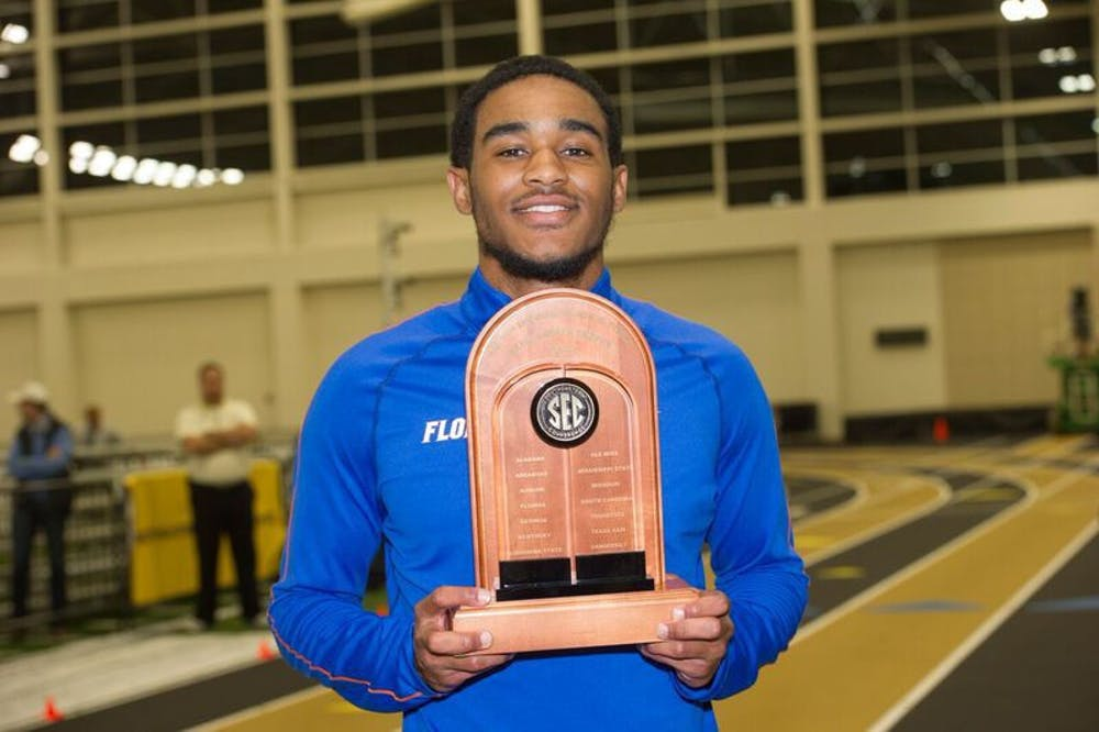 <p>UF's KeAndre Bates poses with a trophy during the SEC Indoor Championships, which ran from Feb. 24-25, 2017, in Nashville, Tennessee. The junior&nbsp;won titles in the men's long jump and men's triple jump.&nbsp;</p>
