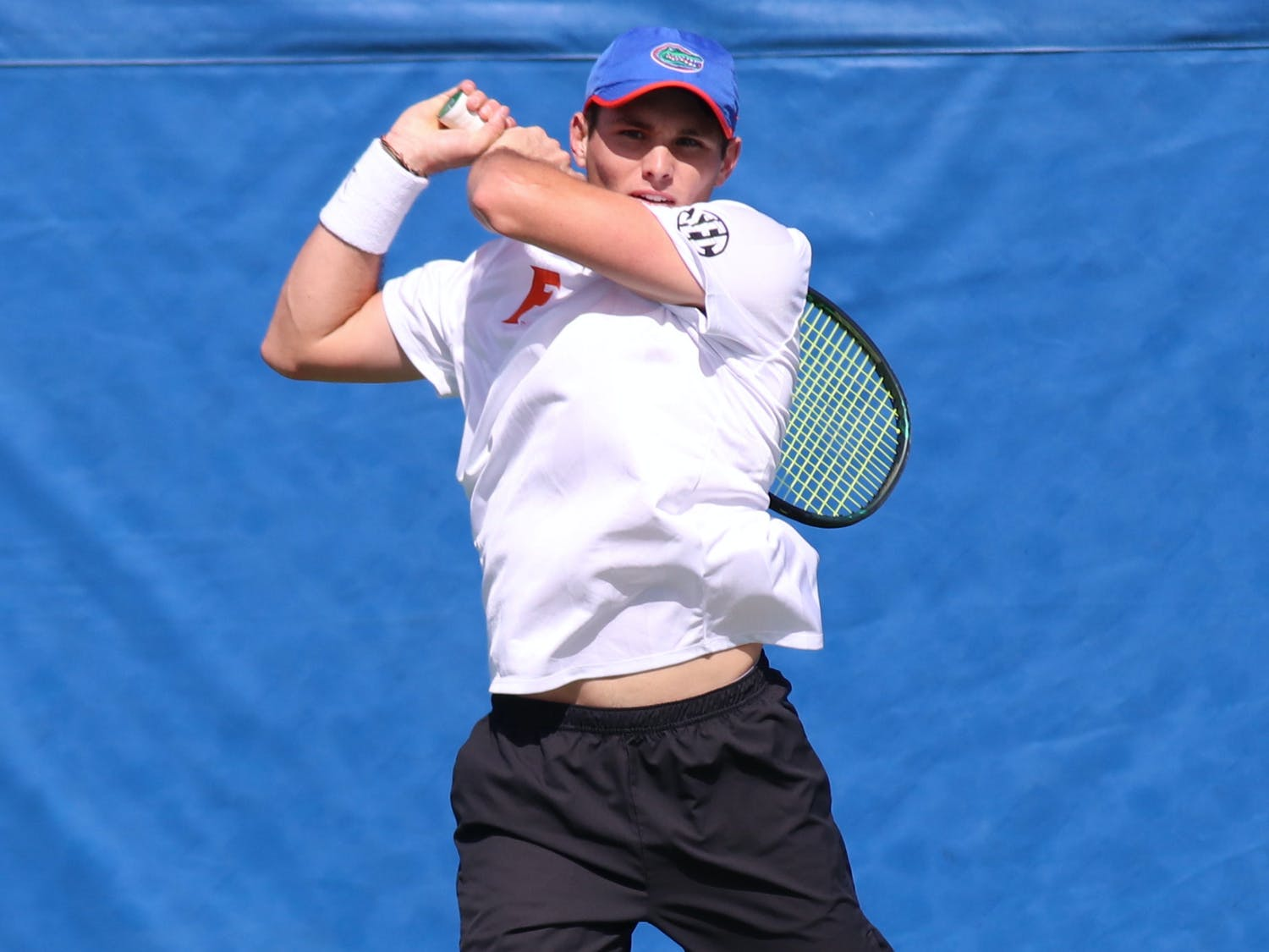 Team captain Sam Riffice and the rest of the Gators marked March 7 at the start of the season. Photo from UF-Auburn match Feb. 21.