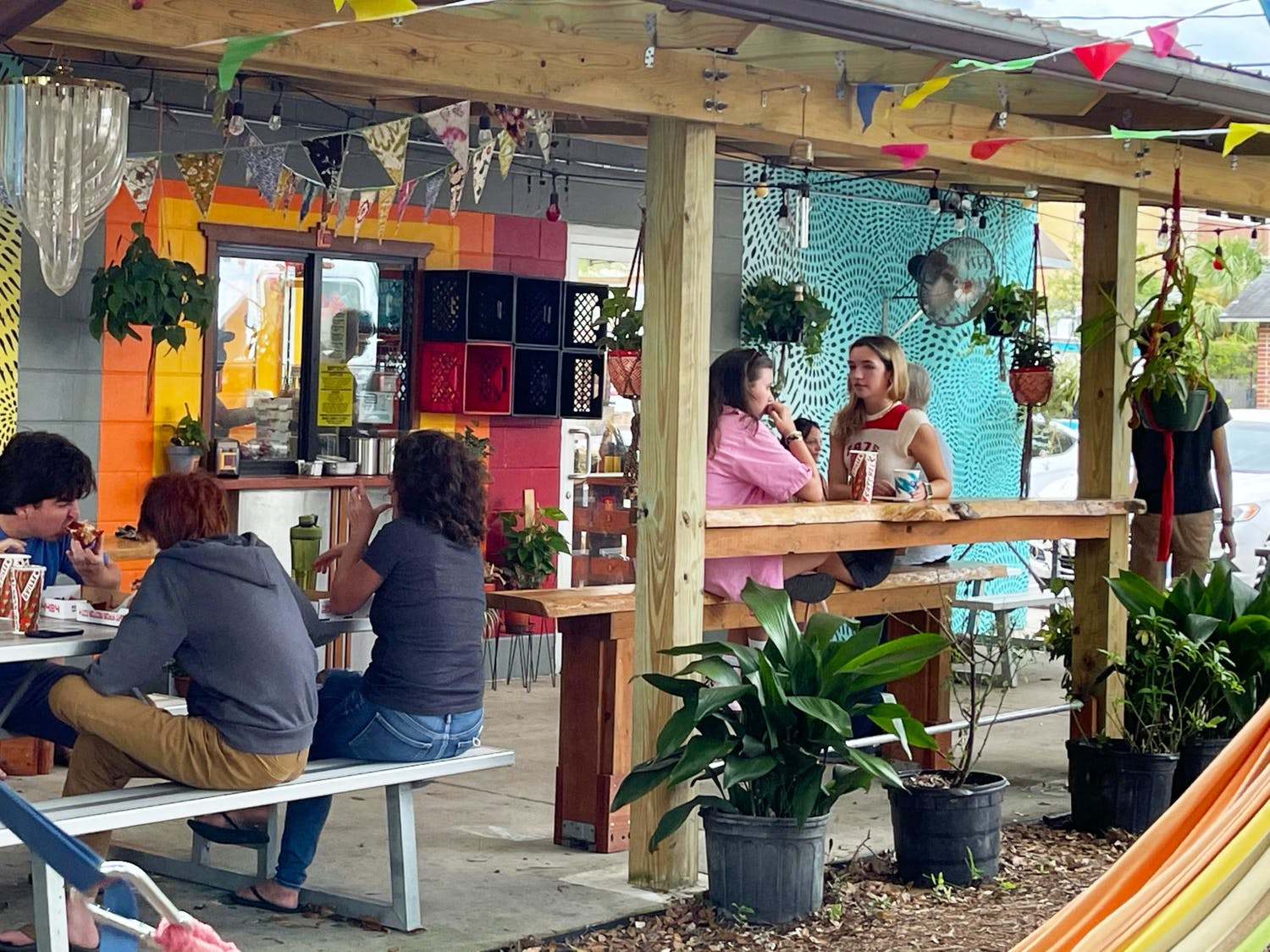 Customers sit outside of Satch² off of 4th Avenue while they eat pizza and waffles on Sunday, July 18, 2021.