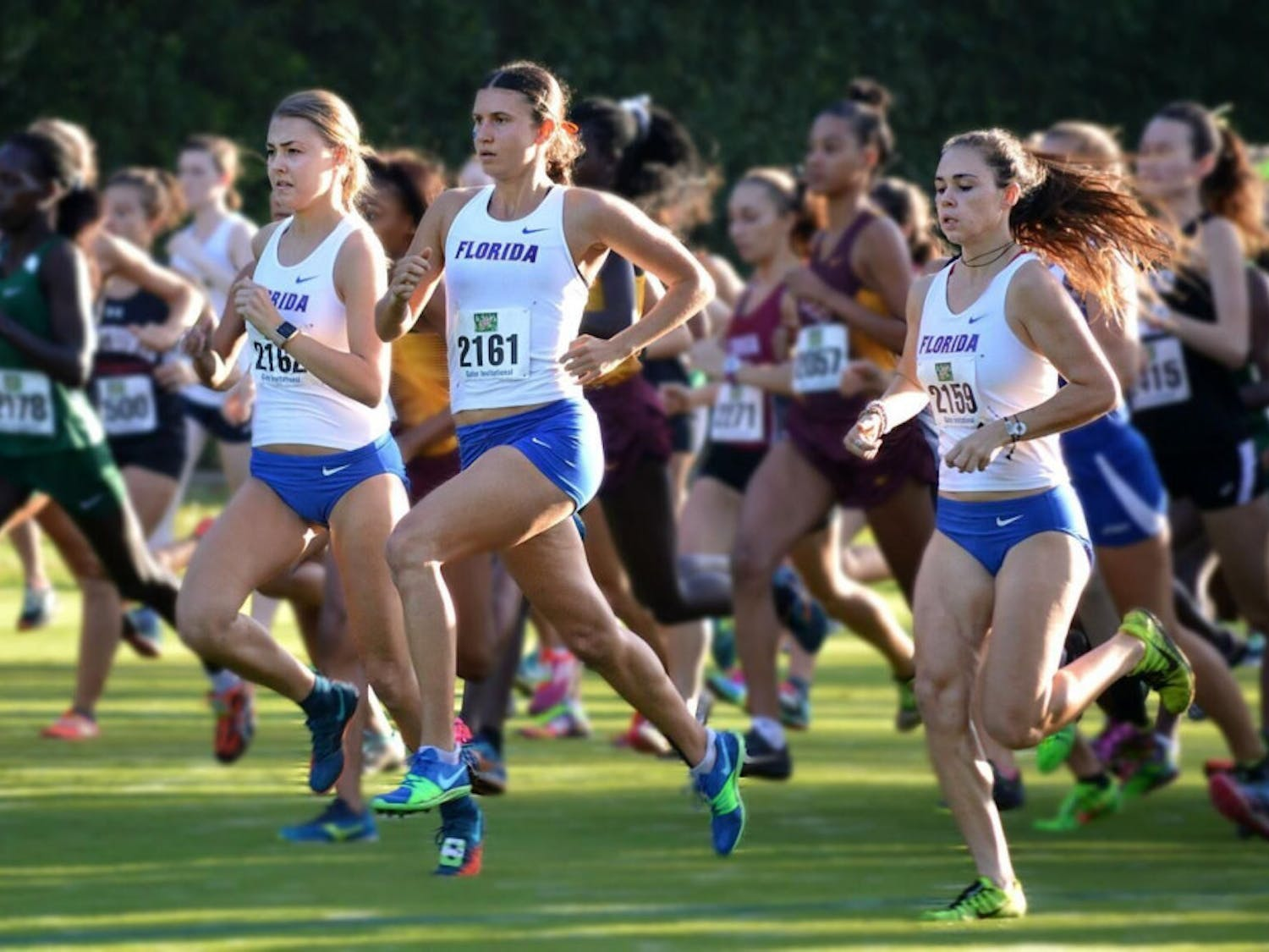 Three members of the Florida women's cross country competing.