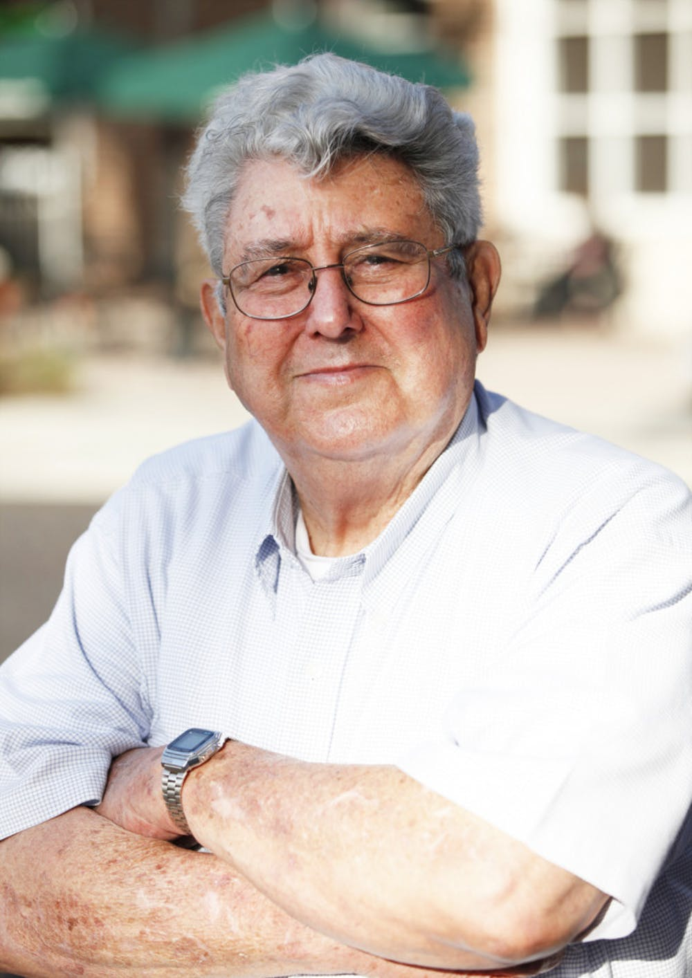 """<p>W.E. """"Mac"""" McEachern, 81, stands on the corner of Southeast Second Place and Southeast First Street on Feb. 12. McEachern is running for District 4 city commissioner.</p>"""