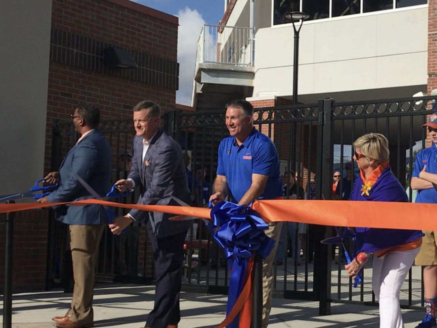 UF softball coach Tim Walton and Athletic Director Scott Stricklin cut the ribbon at the unveiling of the newly renovated Katie Seashole Pressly Stadium before the Gators faced the Japan National Team in an exhibition Tuesday night.