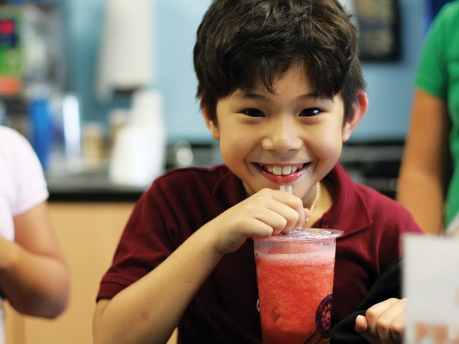 """Peter Nguyen, 9, enjoys a strawberry slush with green apple jelly at Lollicup on Monday afternoon. """"I like it because it tastes good,"""" Nguyen said. His favorite drink is the Oreo Snow."""