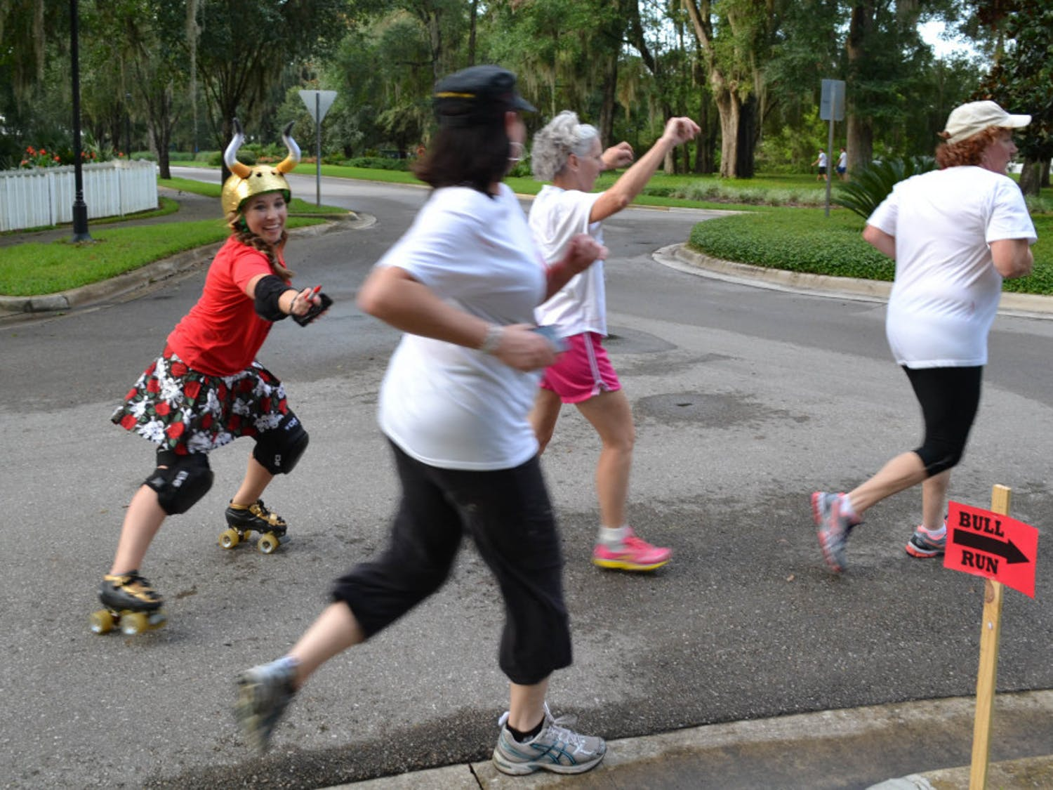 Lily Woodard, who goes by the derby name Slang Blade, chases a group of runners during the Bull Run 5K.