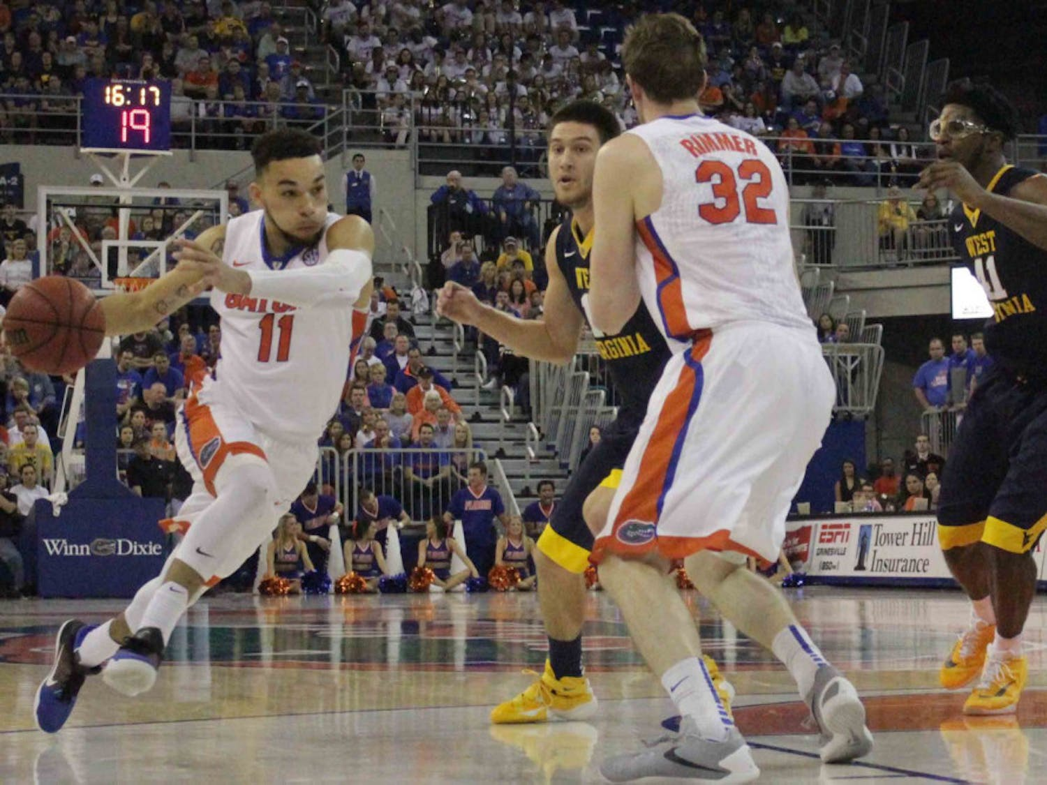 Chris Chiozza drives into the paint during Florida's win over West Virginia on Jan. 30, 2016, in the O'Connell Center.
