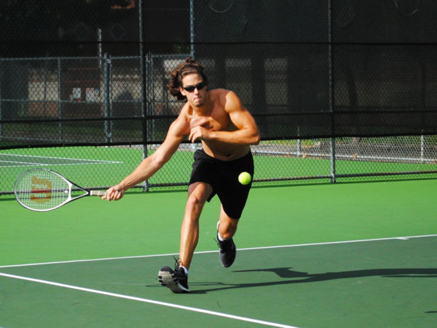 Aaron Crews, a 19-year-old UF health sciences sophomore plays tennis at the Southwest Recreational Facilities on Monday afternoon.