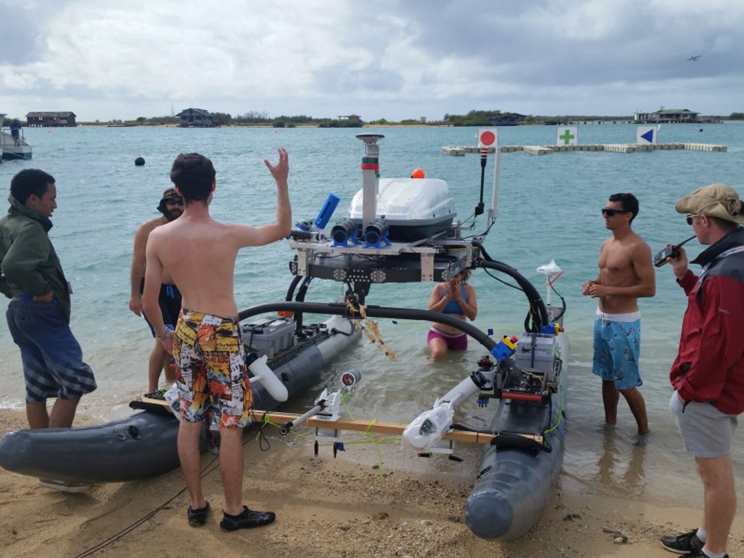 Members of UF's Machine Intelligence Laboratory work on the NaviGator-Autonomous Maritime System, which is an 18-foot long boat with a robot mounted on top that can drive the machine by itself. The team took fourth in the 2018 Maritime RobotX Challenge in Hawaii. Courtesy to The Alligator.