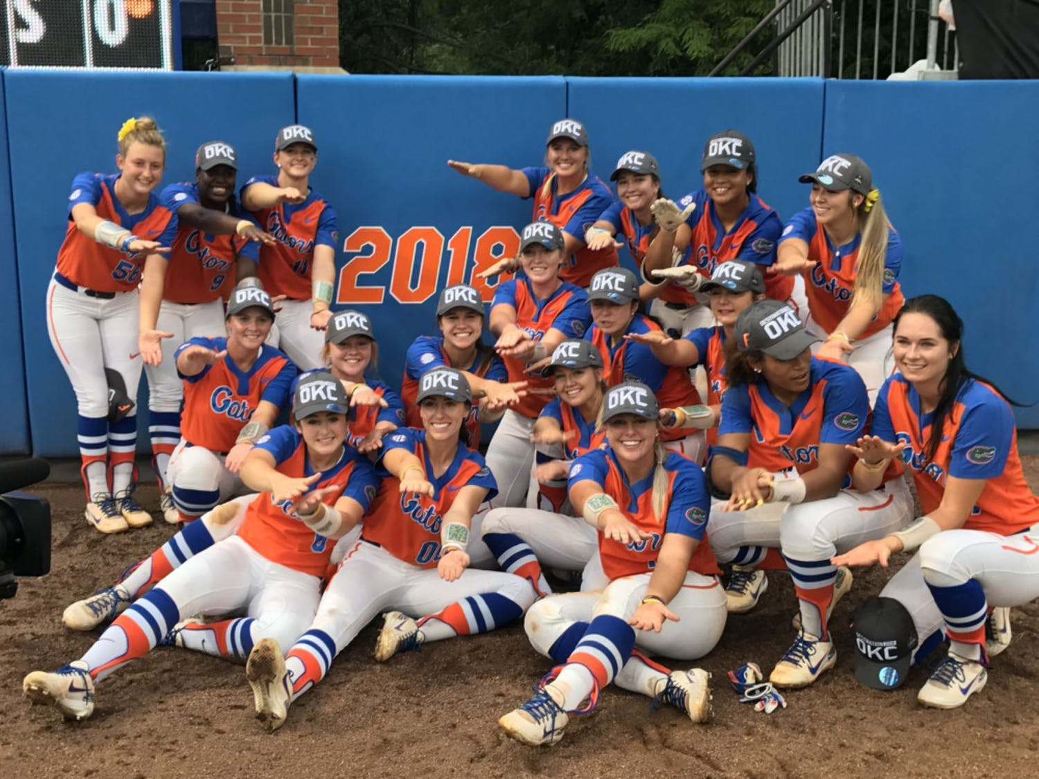 The Florida Gators softball team in front of its newly earned 2018 College World Series sign. UF won on a walk-off home run by freshman Jordan Matthews to send it to Oklahoma City.