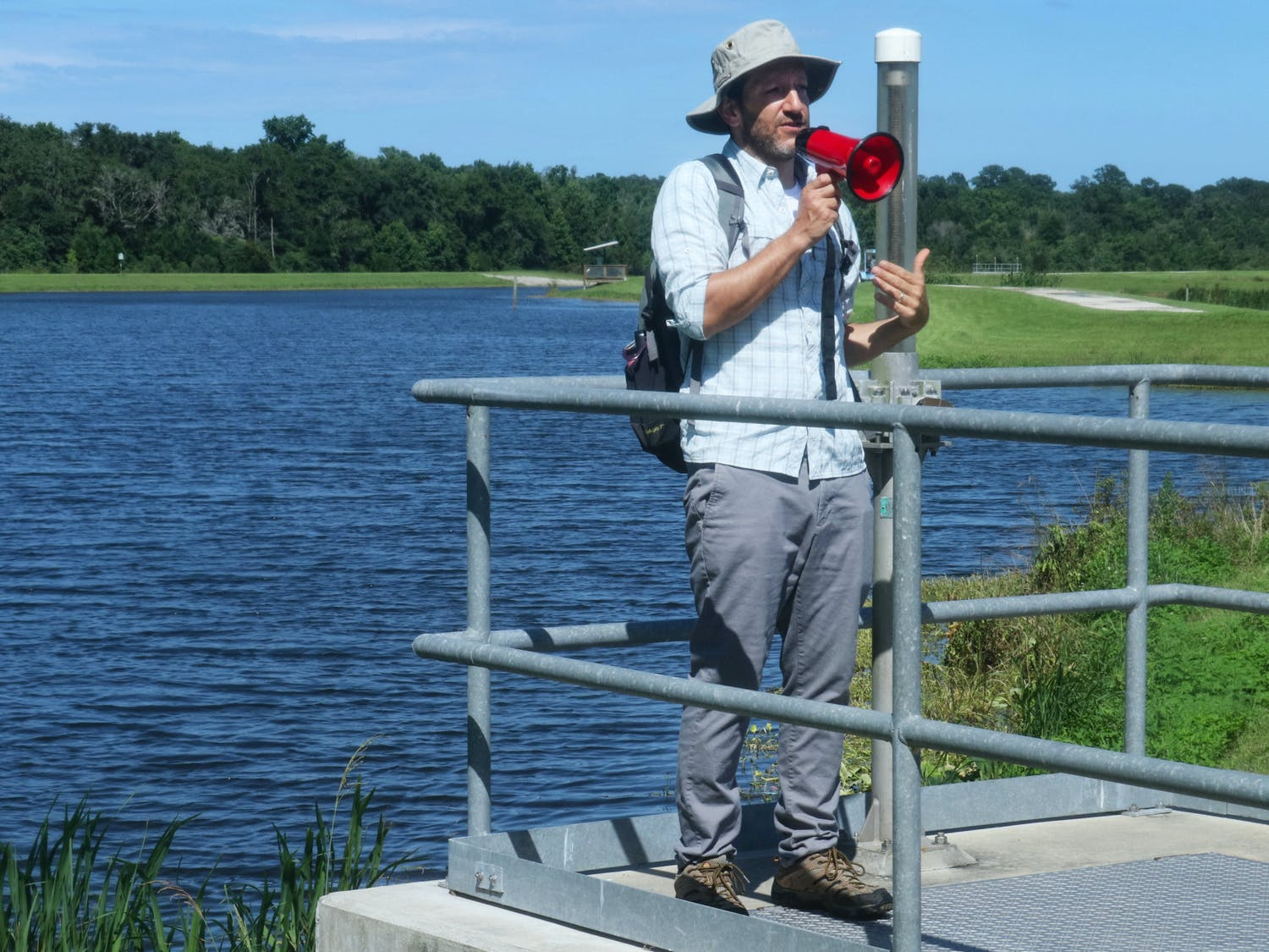 """David Kaplan, an associate environmental engineering professor at UF, gives the Summer Engineering Experience for Kids attendees a tour of Sweetwater Wetlands Park on Monday, June 28, 2021. Kaplan hopes the camp can serve as """"motivation to look to nature for a way to design things that minimize human impact."""""""