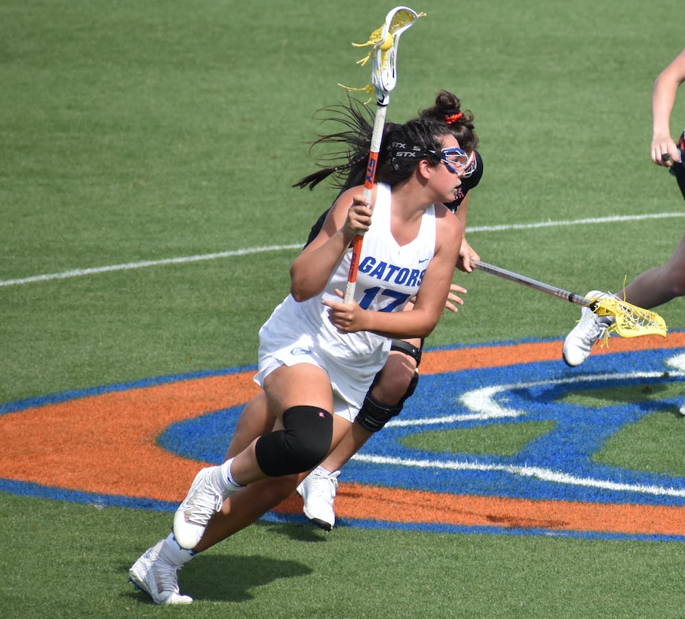 <p>Florida&#x27;s Shannon Kavanagh (No.17, pictured) runs up the field with the ball against Cincinatti March 26. Kavanagh sits five goals short of 200 ahead of Florida&#x27;s regular season finale against Liberty Wednesday. </p>