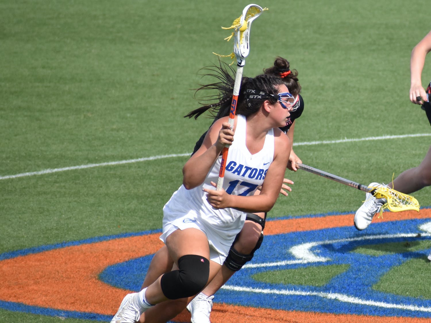 Florida's Shannon Kavanagh (No.17, pictured) runs up the field with the ball against Cincinatti March 26. Kavanagh sits five goals short of 200 ahead of Florida's regular season finale against Liberty Wednesday.