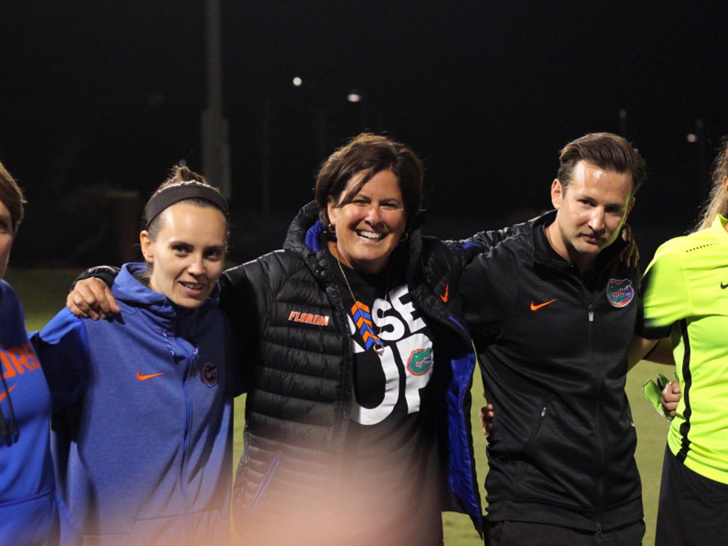 Coach Becky Burleigh (center) celebrates with her team following its victory over USF in the 2017 NCAA Tournament.