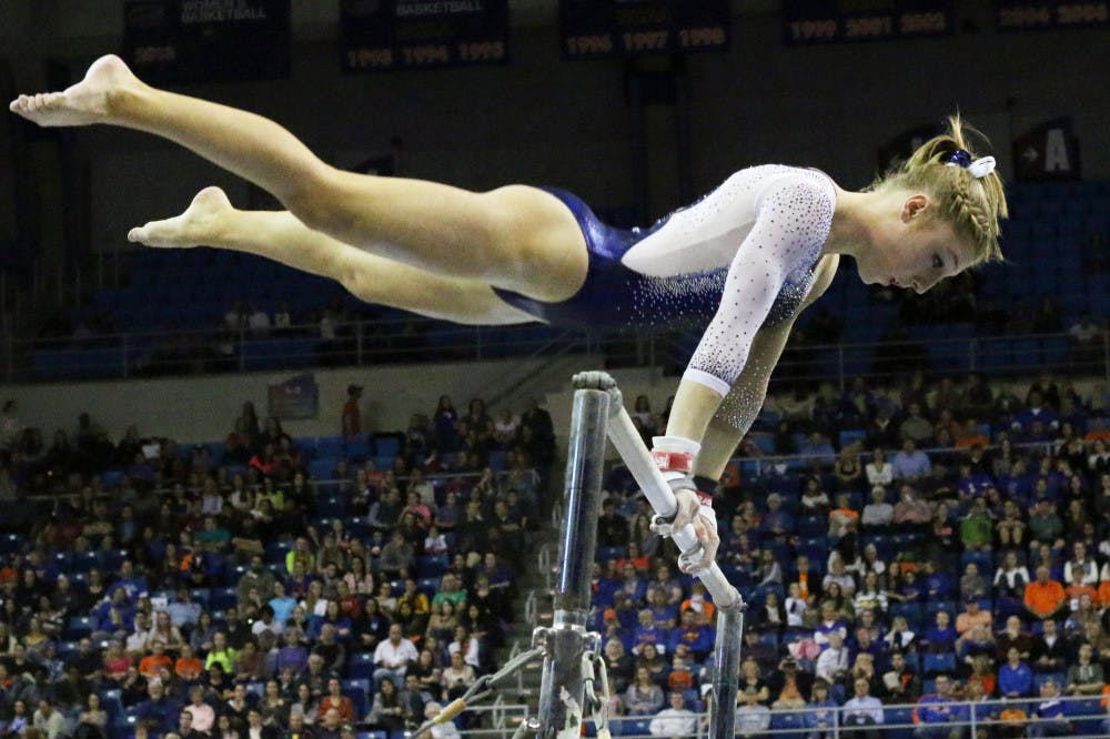 <p>Freshman Alex McMurtry competes on the uneven parallel bars during Florida's win against Auburn on Friday in the O'Connell Center.</p>