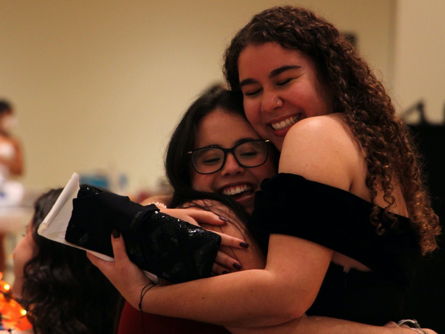 Daniella Duarte (left), 20, UF finance sophomore, receives a hug from her friend Gabriella Barreras (right), 20, UF advertising junior, during the masquerade ball in the Rion Ballroom at the Reitz Union on Thursday, Sept. 16, 2021.