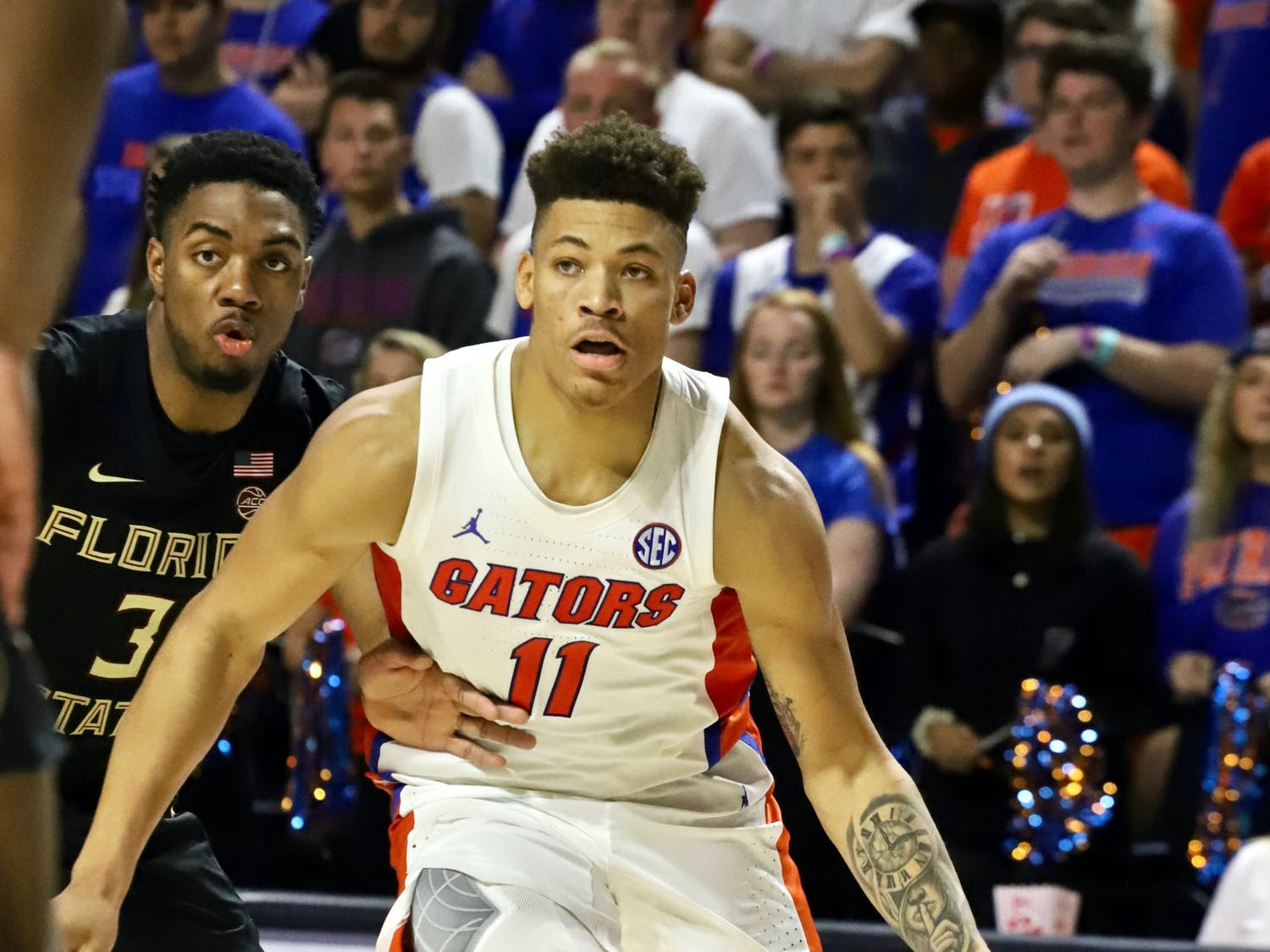 Junior Keyontae Johnson collapsed at midcourt Saturday after a timeout during Florida's game against rival FSU.