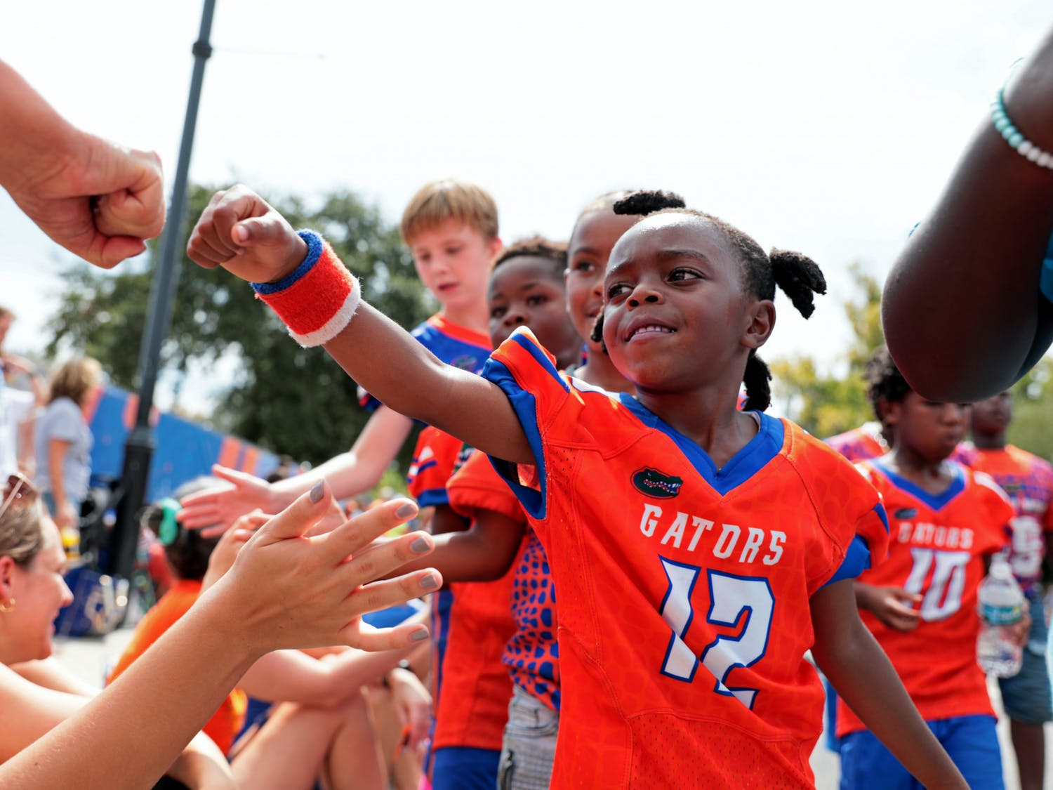 UF Homecoming kicked off with the parade, which returned for the first time since 2019. Dance performances, public figures, marching bands, fire trucks and more entertained the crowd. Some people arrived at 9 a.m. to secure their spot on the sidewalk for the parade.