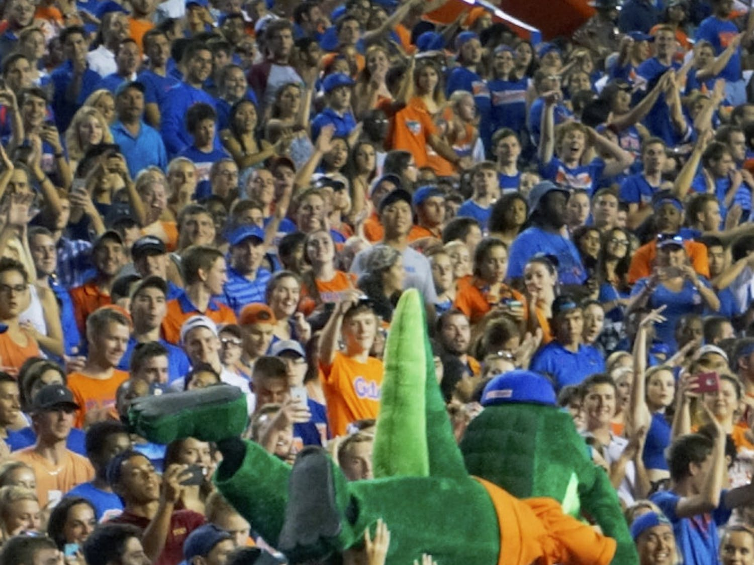 Albert, one of UF's two mascots, surfs the crowd at the football game Sept. 5, 2015. Students and beach balls also traversed across the top of the fray.