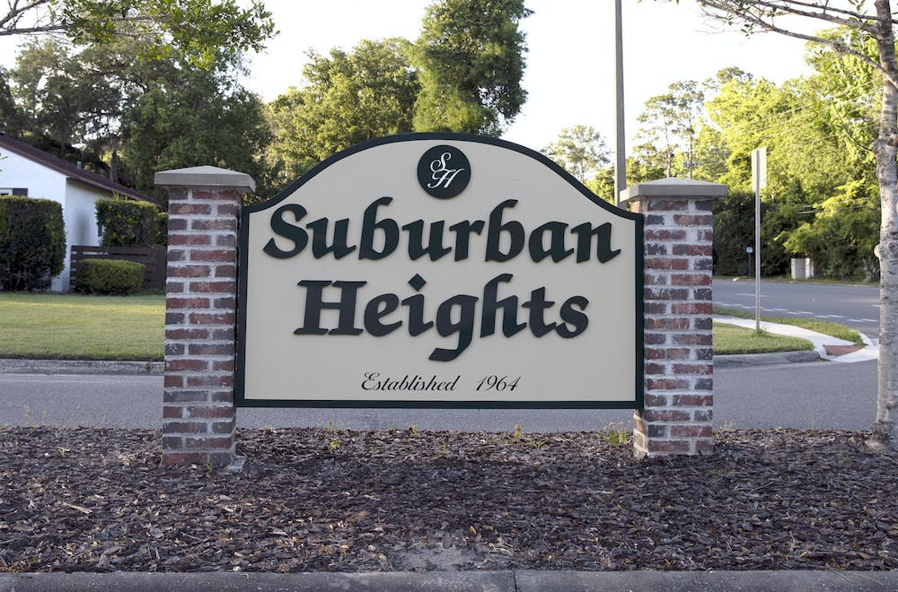 """A """"Suburban Heights"""" sign sits at Northwest 23rd Avenue on Thursday, May 20, 2021."""
