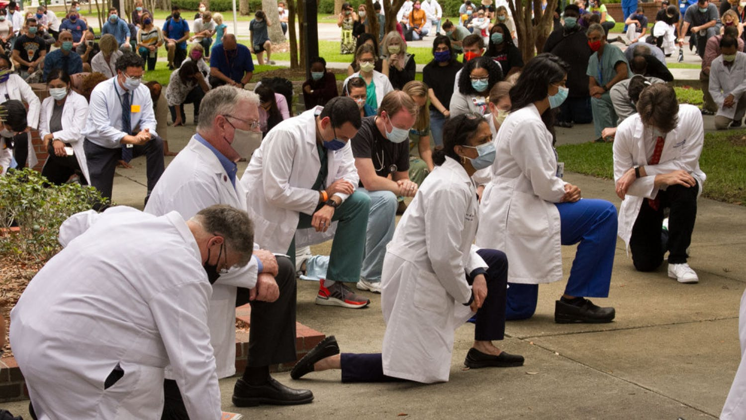 """More than one hundred UF Health faculty, staff and students gathered in front of the College of Nursing in remembrance of George Floyd on June 5. """"I was honored to be among so many people that attended today's fight for black lives and I'm honored to be apart of this crowd,"""" said Dr. Runi Foster, 57, a pulmonologist at the University and the VA Medical Center."""