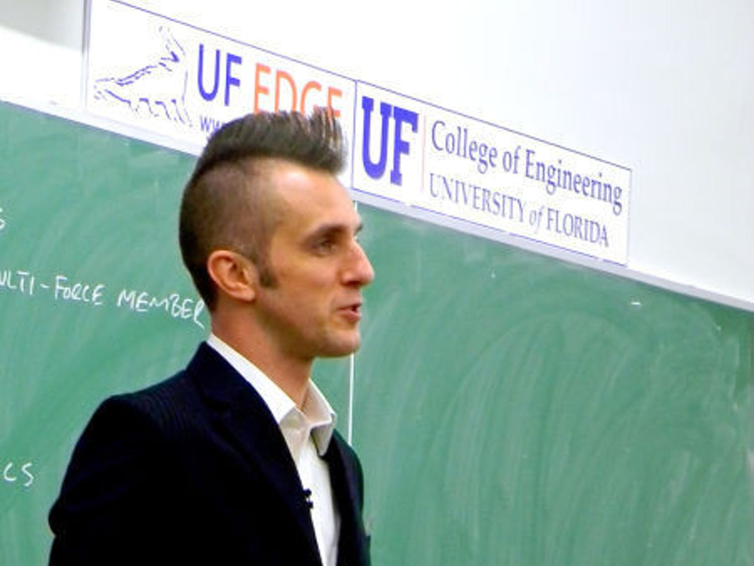 UF engineering professor Dan Dickrell teaches class Wednesday. The professor shaved his hair into a mohawk for basketball season in the style of player Will Yeguete.