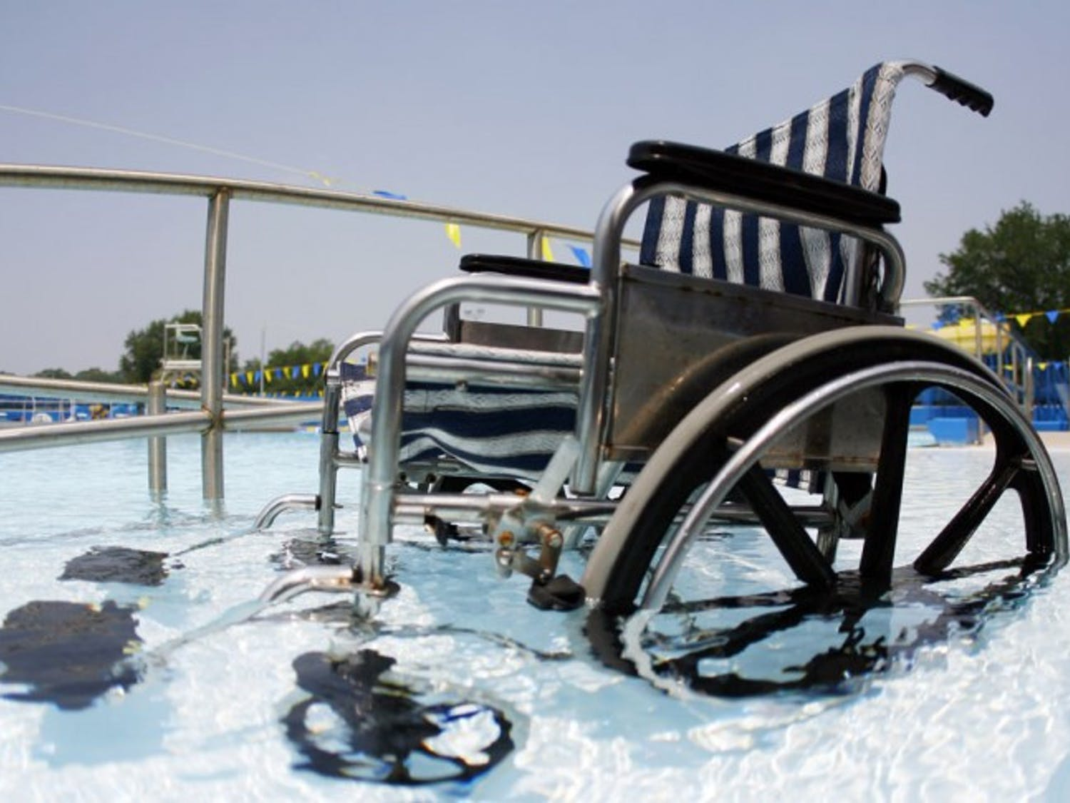 The beach entry wheelchair ramp at Dwight H. Hunter Municipal Pool, also know as the Northeast Pool, is one of two soon-to-be required methods of entry for people with disabilities as part of the Americans with Disabilities Act.