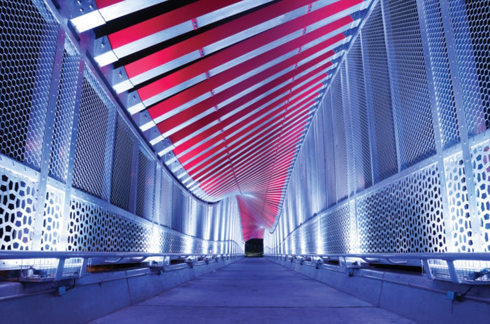 <p>The bridge over 13th Street, nicknamed the DNA bridge, is empty early Thursday morning.</p>