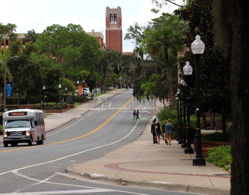 <p>Few students are seen wandering around UF's campus on August 31, 2020, in Gainesville Fla., due to the social distancing guidelines and mask requirements set in place. However, the Campus Connector and RTS buses still operate with frequent trips across campus.</p>