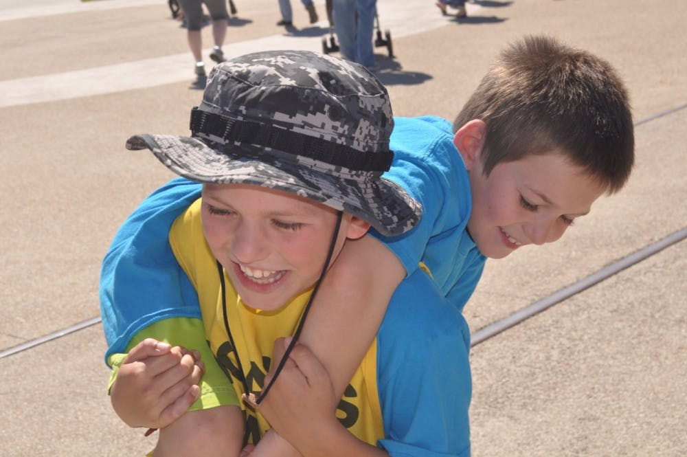 """<p dir=""""ltr""""><span>Noah Barnes, 10, carries his 8-year-old brother Jon at Active Streets Gainesville. Noah stopped in Gainesville on his yearlong march from Key West to Blaine, Washington, to promote diabetes awareness.</span></p><p><span></span></p>"""
