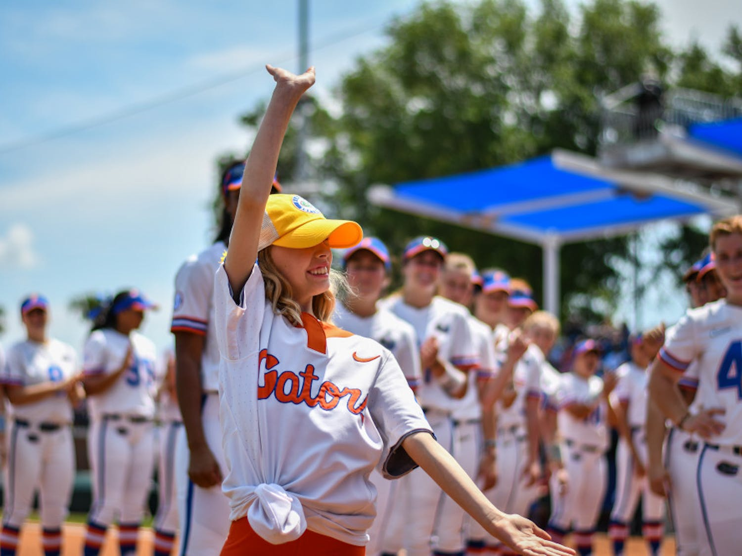 Hartley Georges is introduced with the UF softball team during itsgame against Arkansas on April 7. Georges has been an honorary memberof the team since November.