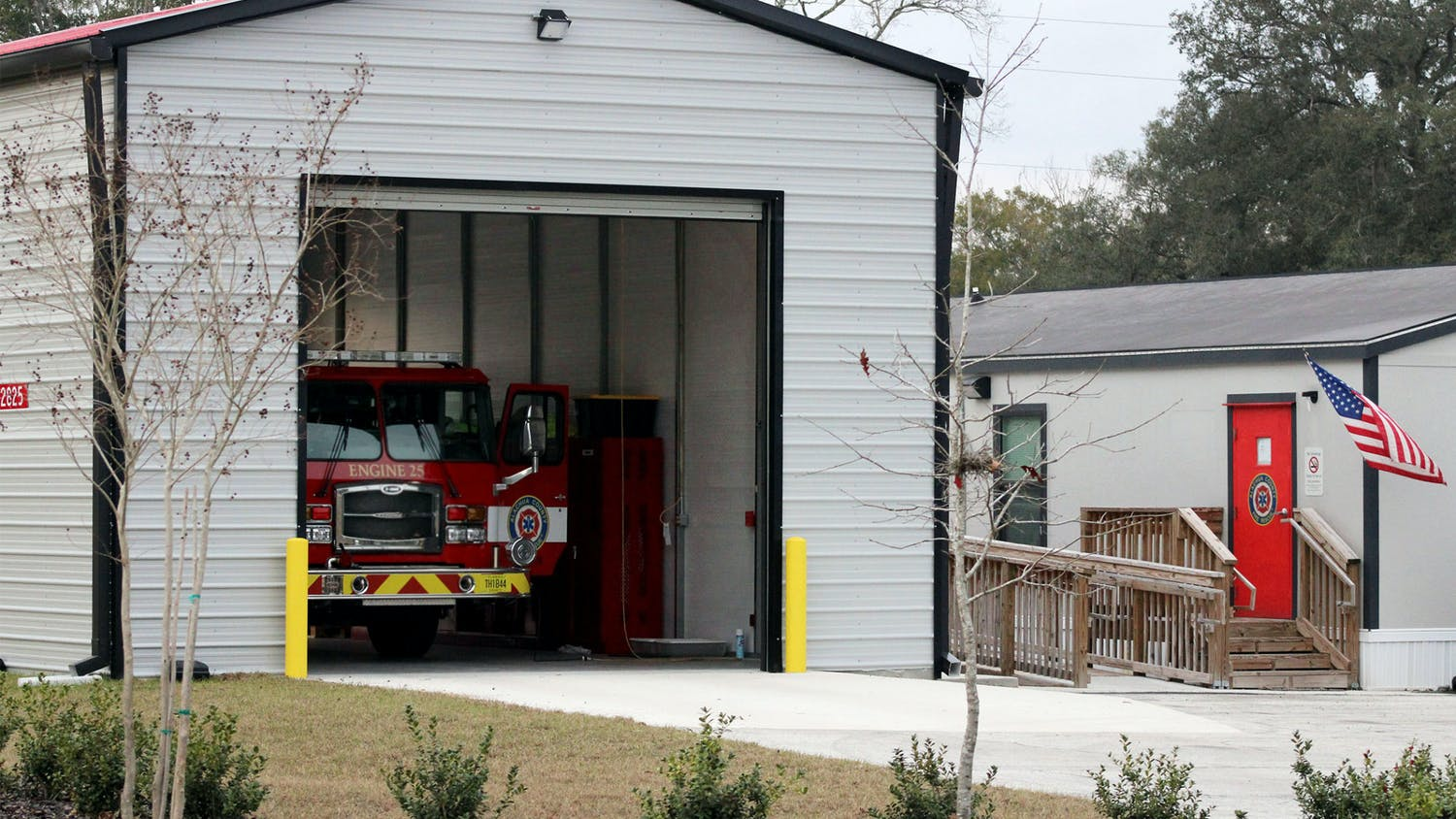 A fire engine sits under a newly constructed shed at the Alachua County Fire Rescue Station 25 on Tuesday, Jan. 26, 2021. The station didn't have an enclosed space for the engine and was not recognized as a fire station when it opened last January, despite being on call and operating as one.