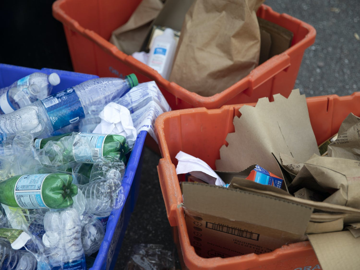 Plastic bottles and cartons were placed inside of orange and blue bins for recycling on Southwest 23rd Drive in Gainesville on Wednesday, May 12, 2021.