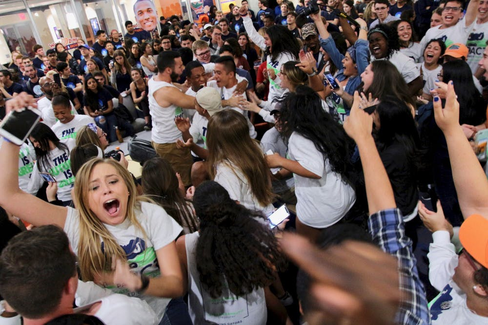 <p>Members of the Impact Party cheer after hearing the results of the 2018 Spring Student Government election. Impact Party swept the execute ticket and claimed a majority of the 50 Student Senate seats.</p>