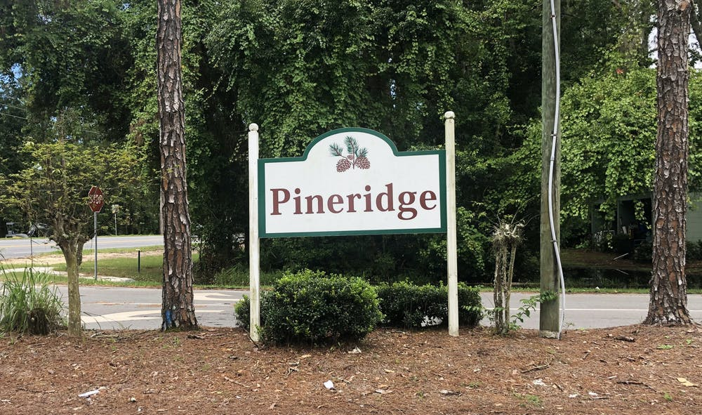 A sign for the Pineridge neighborhood sits at Northwest 34th Boulevard on Saturday, July 10, 2021.