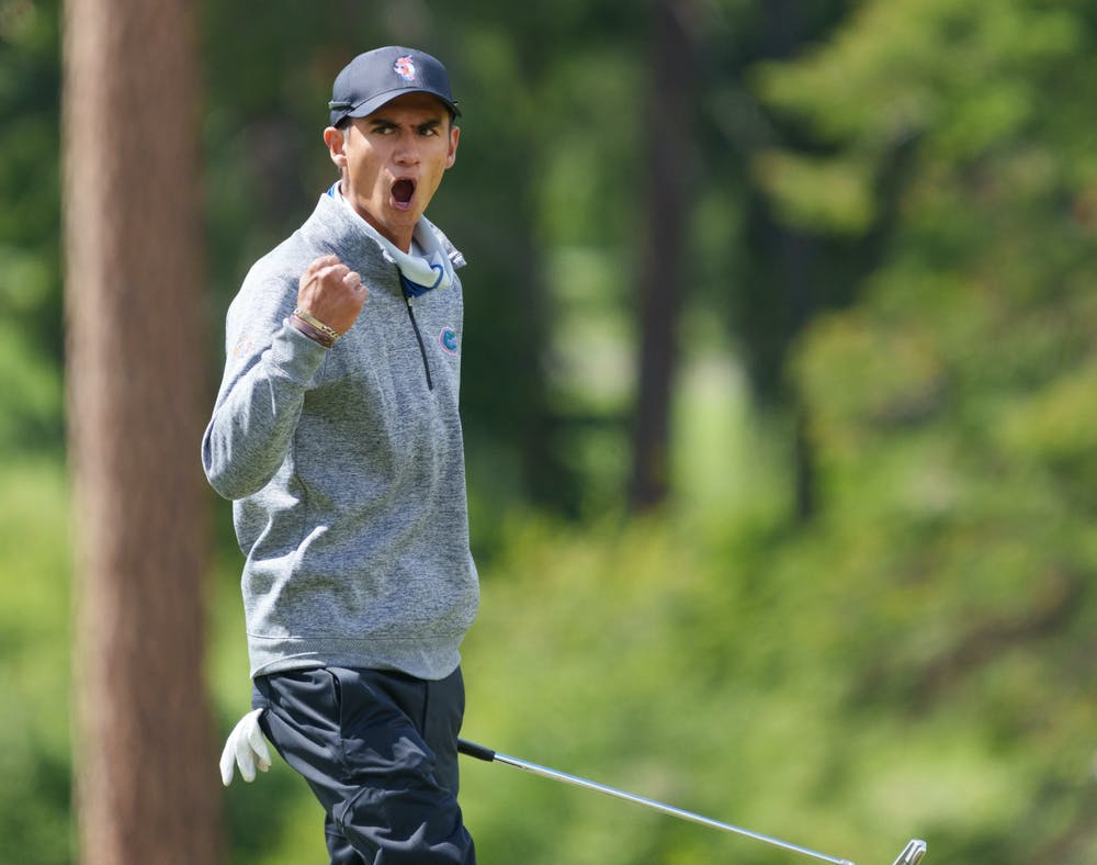 Florida's Ricky Castillo celebrates a putt  in the first round of the 2021 NCAA  Cle Elum Regional at Tumble Creek Golf Club in Cle Elum, Wash., on May 19, 2021. (Photography by Stephen Brashear/Red Box Pictures)