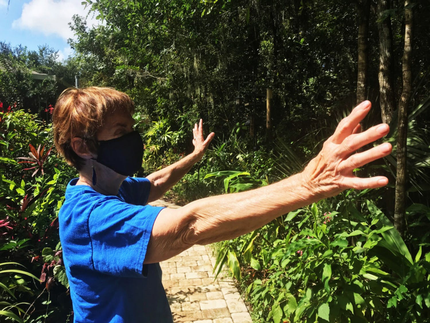 Patsy Nelms, an 83-year-old resident of Oak Hammock, is seen on Sunday, Oct. 11, 2020.Patsy and Warren opted to live in a house surrounded by a lush garden where purple flowers dangle from trees and hummingbirds whiz about.