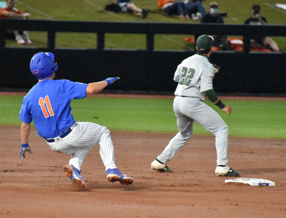 Florida catcher Nathan Hickey slides into second base March 13 against Jacksonville University. Florida takes on USF Friday in the first round of the NCAA Regional.