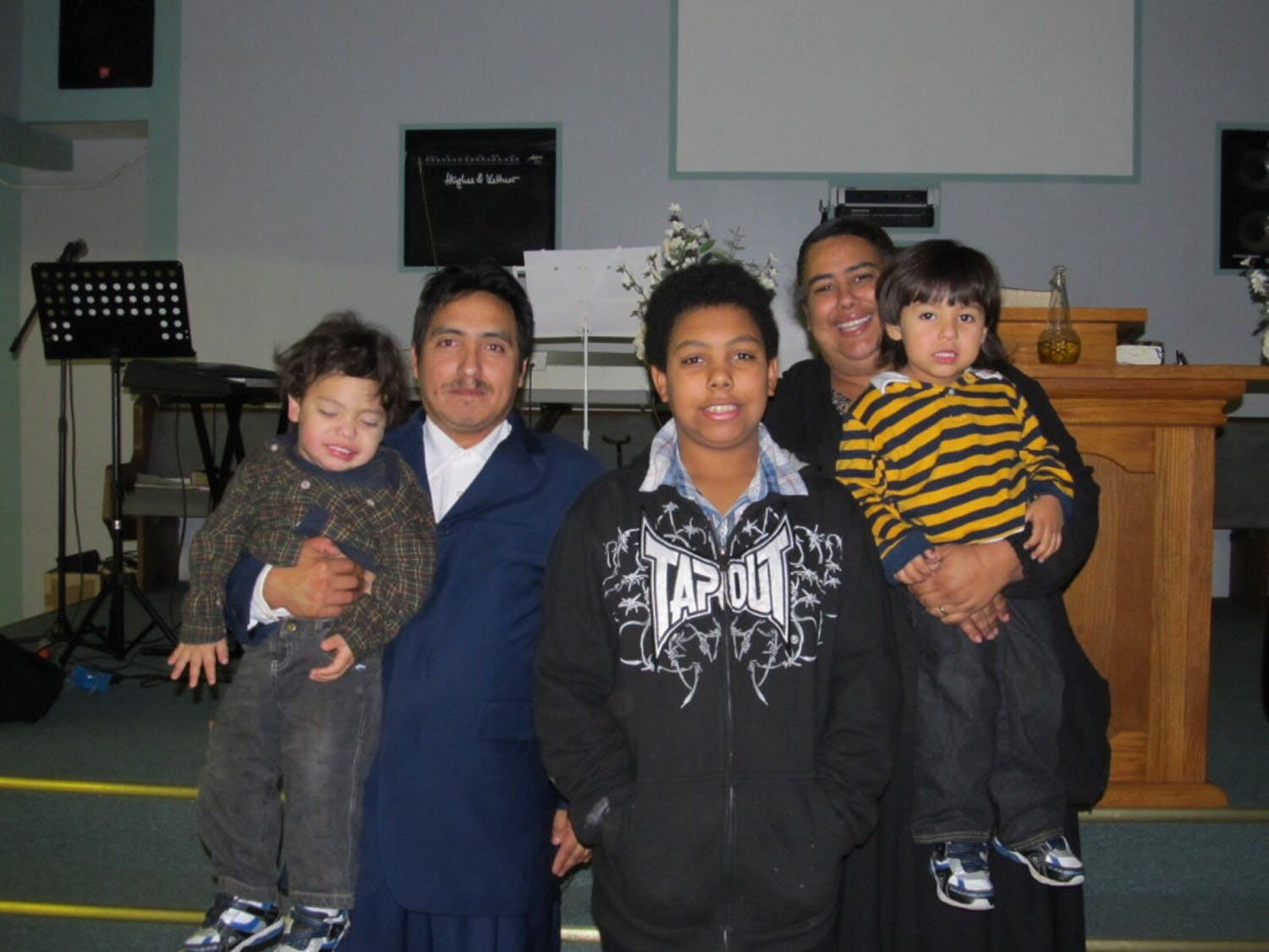 The Flores-Colondres family poses for a photo at an Alabama church in 2010.